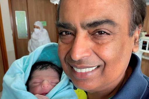 Reliance Industries Chairman Mukesh Ambani with his newborn grandson, the son of Akash Ambani and Shloka Mehta. (Twitter@mpparimal via PTI)