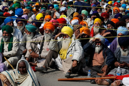 For Representation. Protesting farmers hold a meeting at the Delhi-Haryana border. (File photo/AP)