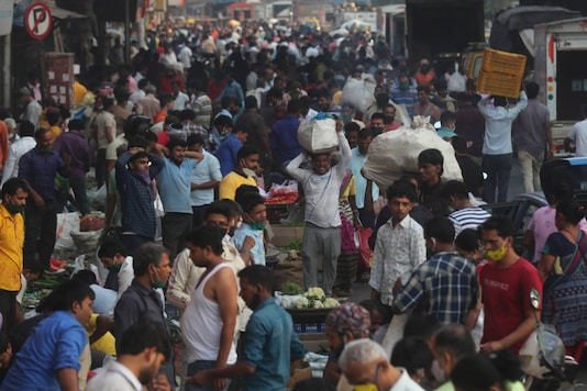 People buy vegetables at a market in Mumbai. (AP Photo/Rafiq Maqbool)