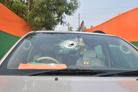 A vehicle in BJP president JP Nadda's convoy damaged after stone-pelting by alleged TMC activists at Sirakal near Diamond Harbour on December 10, 2020. (PTI Photo/Swapan Mahapatra)