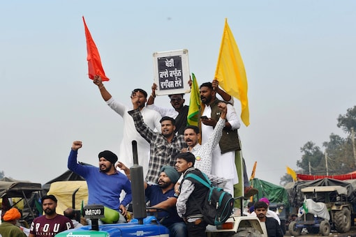 Farmers shout slogans at Singhu border during their 'Delhi Chalo' protest march against the Centre's new farm laws. (PTI photo)