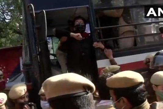 File photo: Police detain AAP leader Atishi Marlena from near residence of Delhi Lieutenant Governor Anil Baijal. (Credits: ANI)