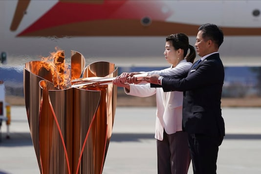 Tokyo Games Torch Relay (Photo Credit: AP)