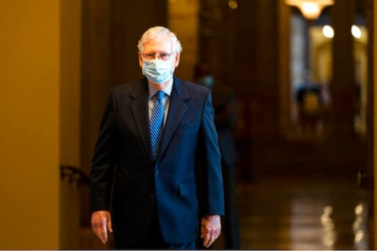 In this Oct. 1, 2020, file photo Senate Majority Leader Sen. Mitch McConnell of Ky. walks towards the Senate floor on Capitol Hill in Washington. (Image: AP)