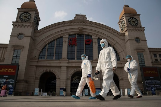 Image for representation. Workers in protective suits walk past the Hankou railway station on the eve of its resuming outbound traffic in Wuhan in central China's Hubei province on Tuesday, April 7, 2020. (AP Photo)