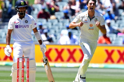 Soon, India's batting mainstay Cheteshwar Pujara too perished. He had no answer to the late swinger from Pat Cummins. (Source: AP)