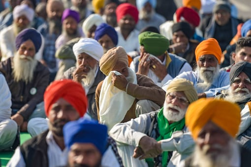 Farmers have been protesting for weeks in Singhu border against Centre's new agri reforms | Image credit: PTI
