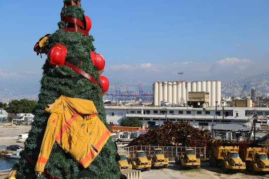 A Christmas tree made by Lebanese artist Hayat Nazer and decorated with uniforms of firefighters and rescuers as a way to pay tribute to those who died at Beirut port explosion, is seen in Beirut, Lebanon. REUTERS/Issam Abdallah