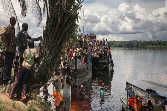 A passenger boat stops for a break on the shores of Ingende. These boats can take weeks to make their way down-river to Kinshasa. (Image courtesy: CNN)