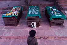 Death by Plastic: Climate Activist Builds Funeral Pyres Out of Bottles to Highlight Pollution