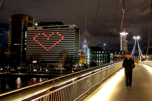 A hotel with lights in some rooms on to form a heart near the buildings of the banking district in in Frankfurt, Germany, Wednesday, Dec. 23, 2020 as Germany continues its second lockdown to avoid the further outspread of the coronavirus. (AP Photo/Michael Probst)