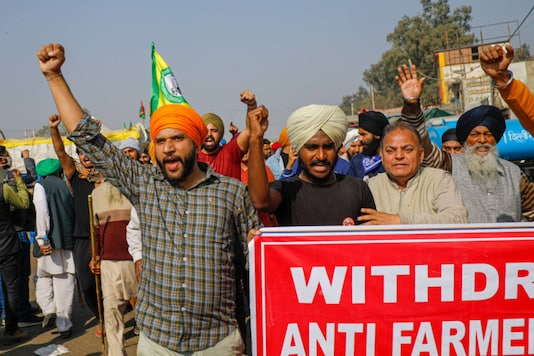 Farmers shout slogans at Singhu border during a protest against the new farm laws, in New Delhi on December 25, 2020. (PTI Photo/Ravi Choudhary)