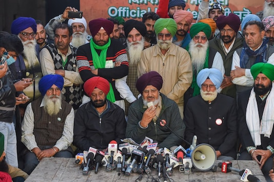 Farmer leaders address a press conference regarding their protest against the new farm laws, at Singhu border in New Delhi, Tuesday, Dec. 22, 2020. (Image: PTI)