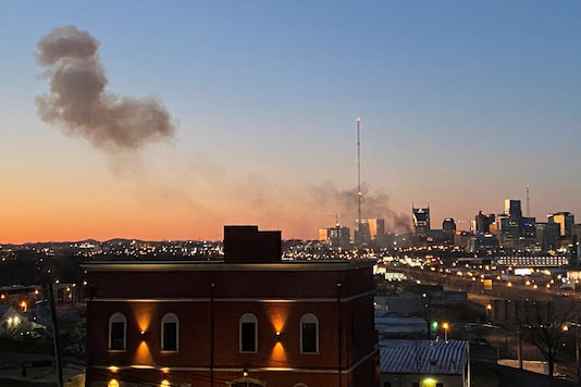 Smoke billows from the site of an explosion in the area of Second and Commerce in Nashville, Tennessee, U.S. December 25, 2020. in this picture obtained from social media. Tom Ward via REUTERS