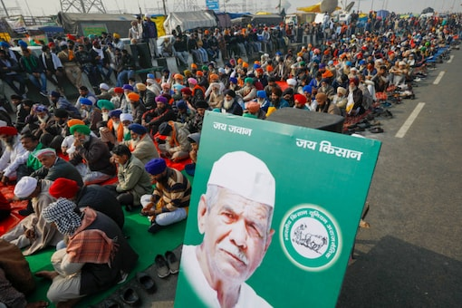 Farmers during their ongoing agitation against new farm laws, in New Delhi on December 26, 2020. (PTI Photo/Ravi Choudhary)