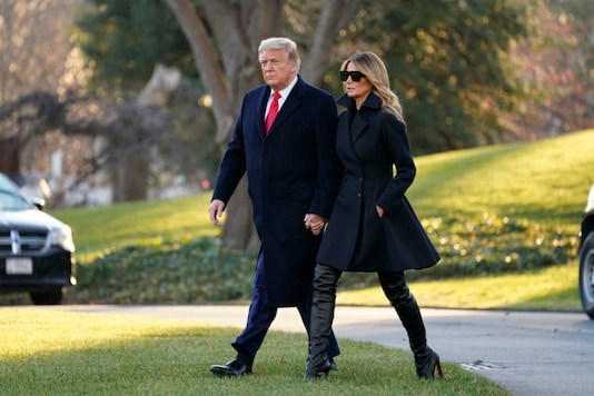 President Donald Trump and first lady Melania Trump walk to board Marine One on the South Lawn of the White House, on December 23, 2020, in Washington. (AP Photo/Evan Vucci)