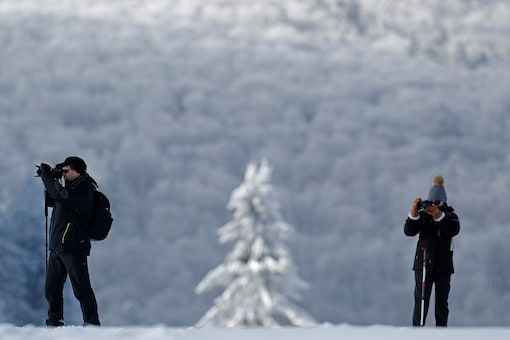 Hikers wear snow shoes as they make pictures on a cold and sunny winter's day in Paris. (Image for representation/REUTERS)
