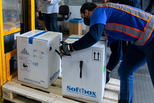 Boxes of Pfizer-BioNtech coronavirus disease (COVID-19) vaccines arrive at an undisclosed location