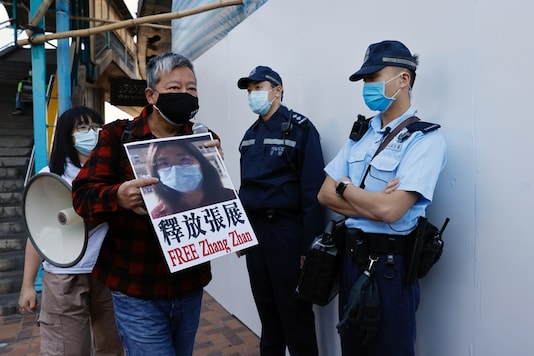 Pro-democracy supporters protest to urge for the release of 12 Hong Kong activists arrested as they reportedly sailed to Taiwan for political asylum and citizen journalist Zhang Zhan outside China's Liaison Office, in Hong Kong, China December 28, 2020. (REUTERS/Tyrone Siu)