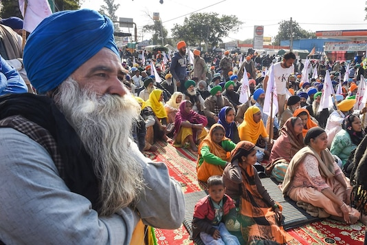 Farmers during their ongoing agitation against the new farm laws, at Singhu border in New Delhi, Monday, Dec. 28, 2020. (PTI Photo/Shahbaz Khan)