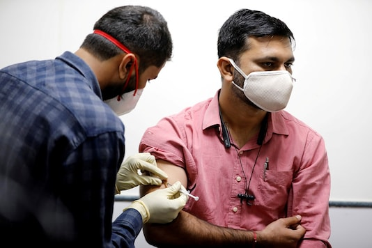 A medic administers an experimental COVID-19 vaccine to a health worker during trials in Ahmedabad. (REUTERS)