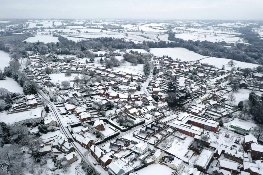 Heavy snowfall in parts of England has led to traffic disruptions, prompting authorities to issue warnings against unnecessary travels. There were reports of heavy snowfall in areas such as Gloucestershire, Worcestershire and Staffordshire as well as in Birmingham and Stourbridge, and lighter dustings as far south as Devon. Here is an aerial view of snow-covered houses in the village of Oulton in Staffordshire, England. (Tom Leese/PA via AP)