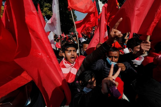 Nepalese supporters of the splinter group in the governing Nepal Communist Party participate in a protest in Kathmandu, Nepal, Tuesday, Dec 29, 2020. (Image: AP/PTI)