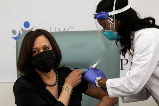 U.S. Vice President-elect Kamala Harris receives a dose of the Moderna COVID-19 vaccine at United Medical Center in Washington, U.S., December 29, 2020. REUTERS/Leah Millis