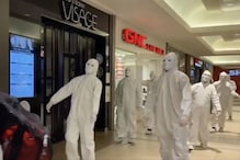 Straight from Dystopia: Anti-Maskers Walk Like Zombies in PPE Suits and Tell Scientists They're Stupid