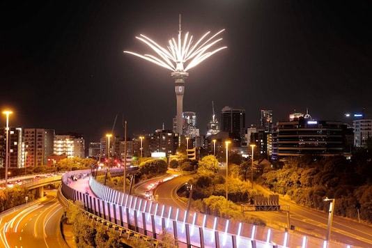 Fireworks are launched from the Sky Tower to mark the changing of the year on New Year's eve in Auckland, New Zealand, Thursday, Dec. 31, 2020. New Zealand and its South Pacific island neighbors have no COVID-19, and New Year celebrations there are the same as ever. (Michael Craig/NZ Herald via AP)