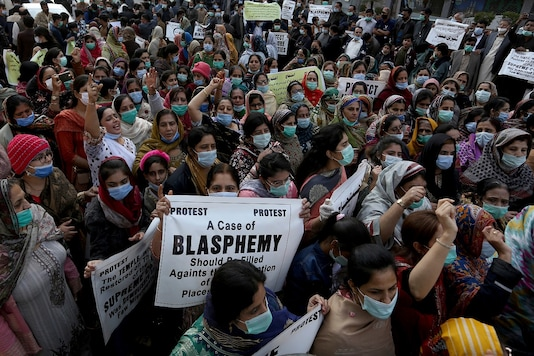 Members of Pakistan Hindu Council hold a protest against the attack on a Hindu temple in the northwestern town of Karak, in Karachi on Thursday. (AP/PTI photo)