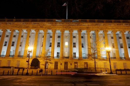 A vehicle drives past the U.S. Treasury Department in Washington, D.C., U.S. December 13, 2020. Picture taken with a long exposure. Picture taken December 13, 2020. REUTERS/Raphael Satter