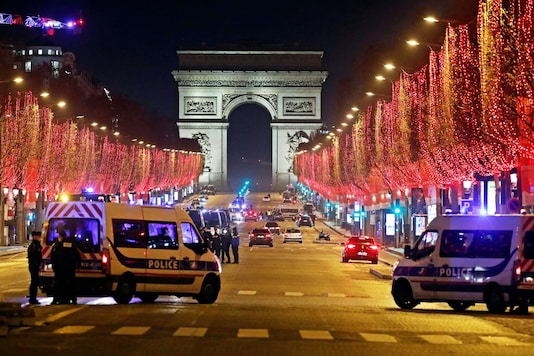 French police patrol on the Champs Elysees avenue in Paris after celebrations and gatherings have been banned due to COVID-19 restrictions amid the coronavirus disease outbreak in France, December 31, 2020. REUTERS