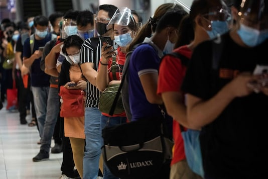 Passengers wearing face masks and face shields for protection against the coronavirus disease queue for bus rides at the Paranaque Integrated Terminal Exchange, in Paranaque City, Metro Manila, Philippines, December 29, 2020. (REUTERS)