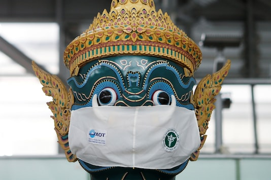 A Thai traditional giant statue wears a protective mask, amid the coronavirus disease (COVID-19) pandemic, at Suvarnabhumi Airport in Bangkok, Thailand December 15, 2020. REUTERS/Soe Zeya Tun/Files