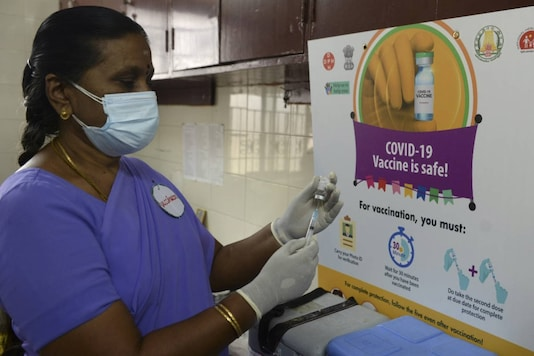 A health official prepares a vaccine kit as she takes part in dry run or a mock drill for Covid-19 vaccine delivery at a primary health centre in Chennai on January 2, 2021. (Photo by Arun SANKAR / AFP)