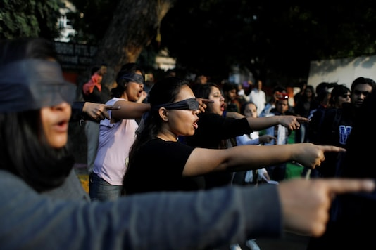 Protestors wearing blindfolds take part in a protest to oppose violence against women in India, in New Delhi. (Reuters)