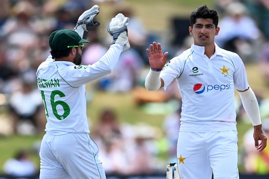 Pakistan's Mohammad Rizwan celebrates with bowler Naseem Shah, right, after dismissing New Zealand batsman Henry Nicholls during play on day four of the first cricket test between Pakistan and New Zealand at Bay Oval, Mount Maunganui, New Zealand, Tuesday, Dec. 29, 2020. (Andrew Cornaga/Photosport via AP)
