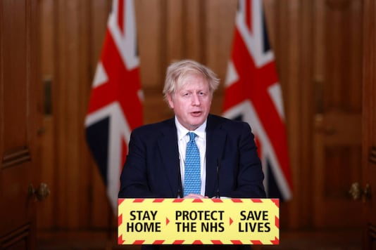Britain's Prime Minister Boris Johnson speaks during a news conference in response to the ongoing situation with the coronavirus pandemic, inside 10 Downing Street in London, on January 5, 2021. (Hannah McKay/Pool photo via AP)