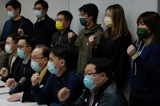 Pro-democratic party members shout slogans in response to the mass arrests during a press conference in Hong Kong Wednesday, January 6, 2021. (Image: AP)
