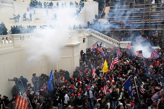 Police release tear gas into a crowd of pro-Trump protesters during clashes at a rally to contest the certification of the 2020 U.S. presidential election results by the US Congress, at the US Capitol Building in Washington. (Reuters)