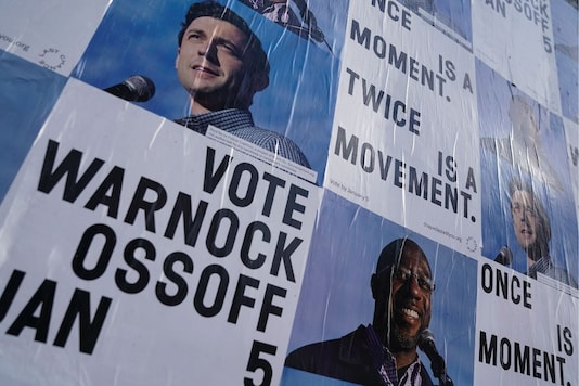Campaign ads for Jon Ossoff and Raphael Warnock seen on a wall in Atlanta, Georgia. (Reuters)