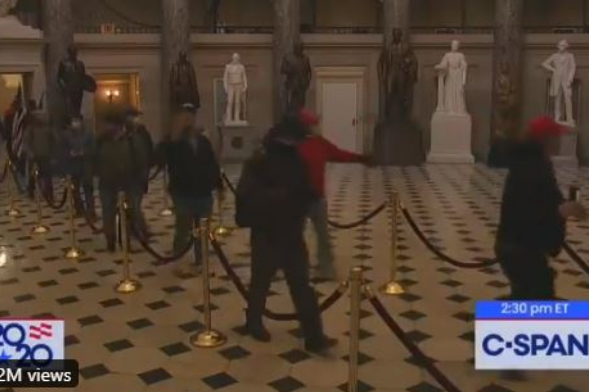 Photos show Trump supporters walk inside red rope dividers after breaking into the Capitol. Credits: @ZackBornstein/Twitter.