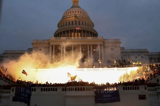 An explosion caused by a police munition is seen while supporters of US. President Donald Trump gather in front of the US Capitol Building in Washington. (Reuters)