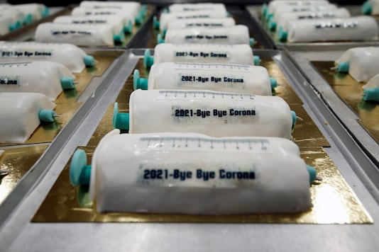 Cakes in the shape of syringes are seen at the Schuerener Backparadies bakery, as the vaccination rollout against the coronavirus disease (COVID-19) continues, in Dortmund, Germany, January 8, 2021. REUTERS/Leon Kuegeler