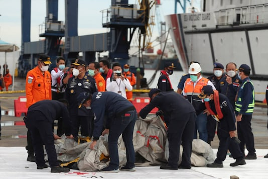 Rescuers inspect wreckage found in the waters around the location where a Sriwijaya Air passenger jet lost contact with air traffic controllers shortly after takeoff