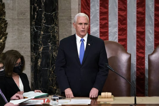 Vice President Mike Pence listens after reading the final certification of Electoral College votes cast in November's presidential election during a joint session of Congress after working through the night, at the Capitol in Washington, on January 7, 2021. (AP Photo/J. Scott Applewhite, Pool)