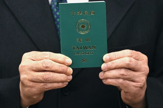 Taiwan Foreign Minister Joseph Wu takes photos with a sample of the new Taiwan passport in Taipei, Taiwan, January 11, 2021. REUTERS/Ann Wang