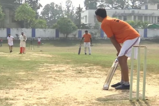 Cricketers during a match in Madhya Pradesh and donning mundu and dhoti.