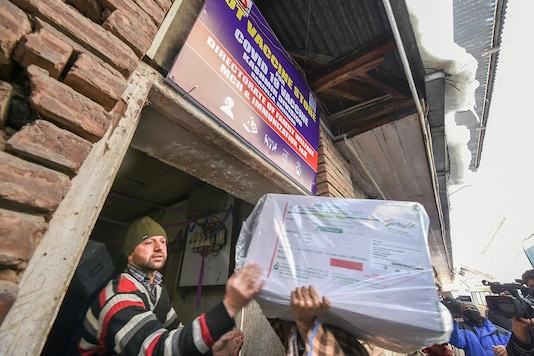 Medical department workers unload boxes of COVID-19 vaccines from a vehicle at cold storage of a hospital, in Srinagar on Wednesday. (PTI)